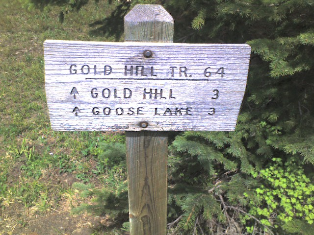 Sign at the trail head of the Gold Hill Trail (TR 64)